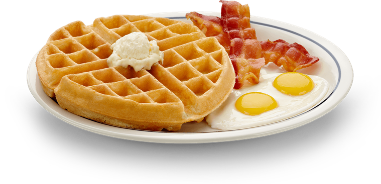 vector library stock A Belgian waffle crowned with fruit topping and served with two eggs